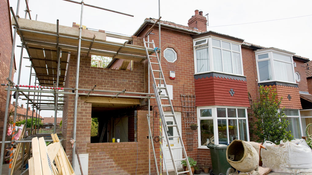 scaffolding is seen around a home extension