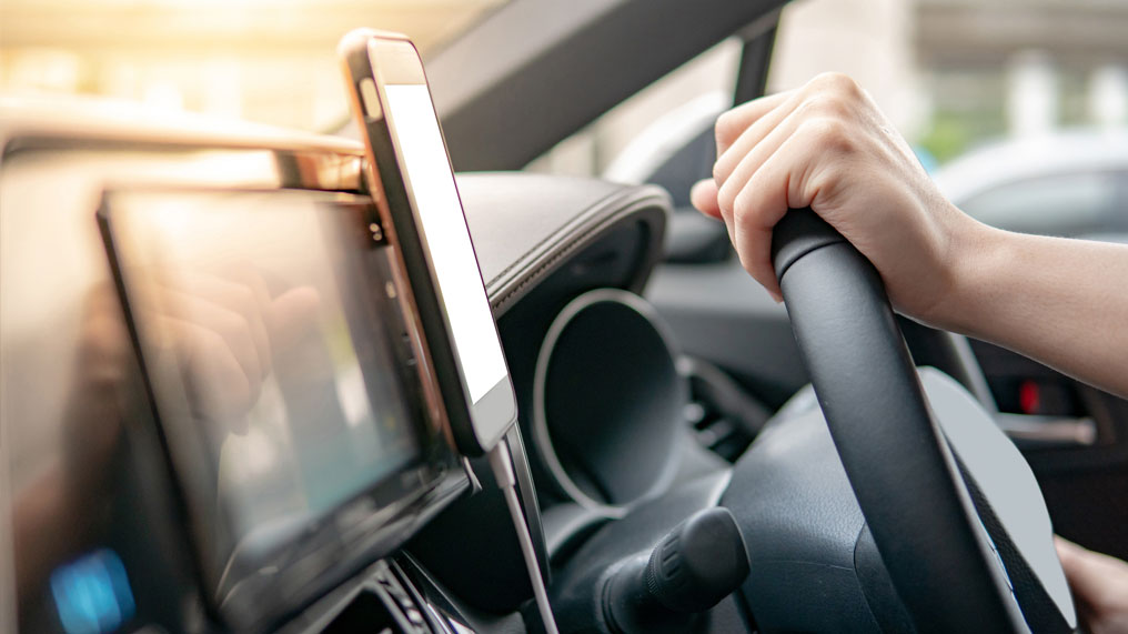 a smartphone is attached to the dash of a car