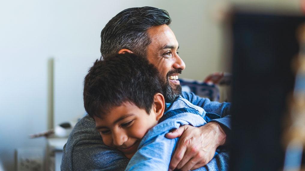 A father and son hug