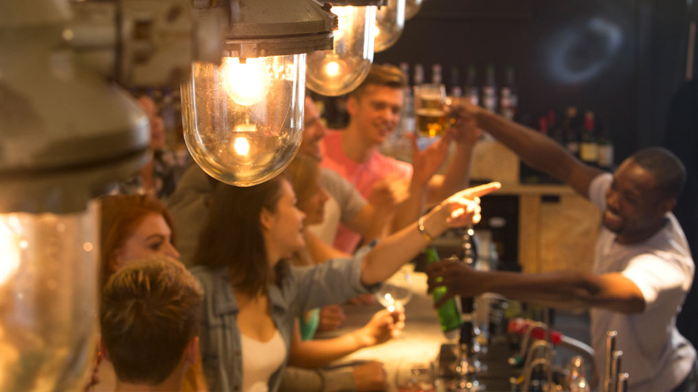 Friends socialising in a bar
