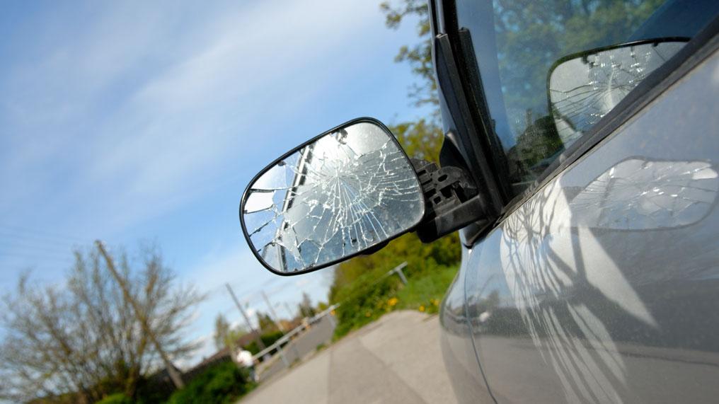 a car has a broken wing mirror