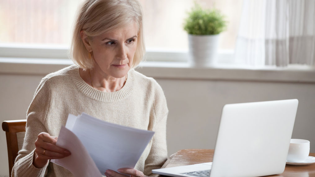a woman looks over some paperwork