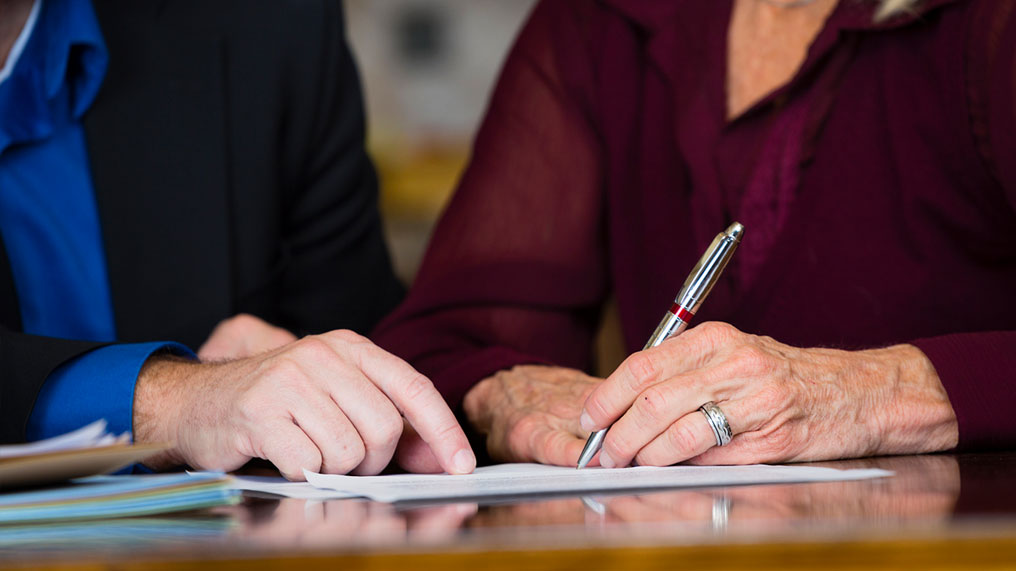 A person signs a document