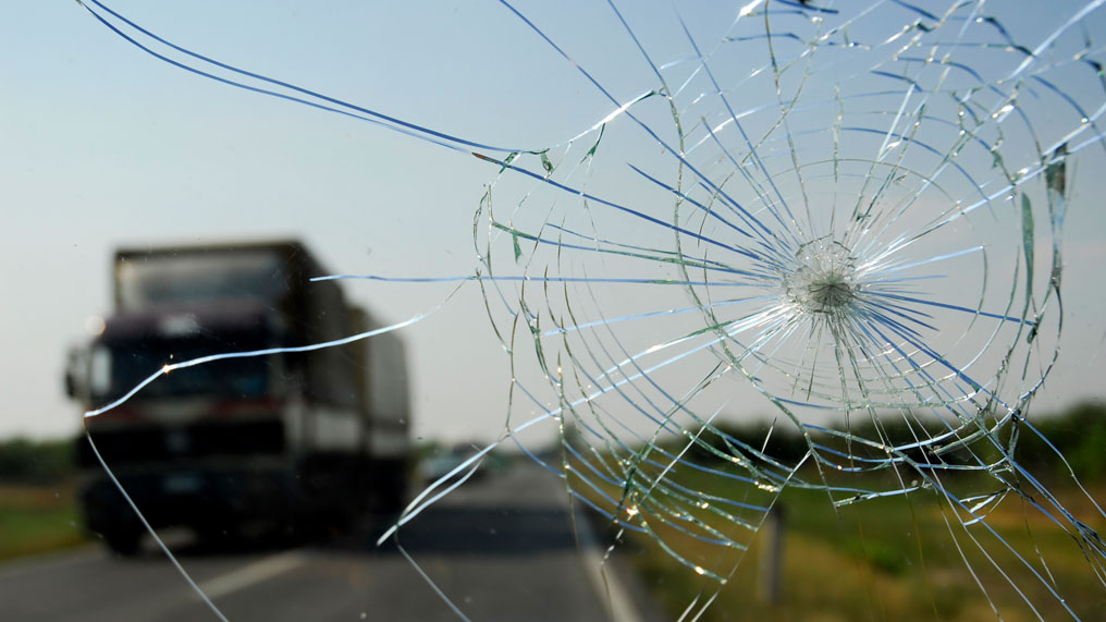 a cracked windscreen obscures the view from within a car