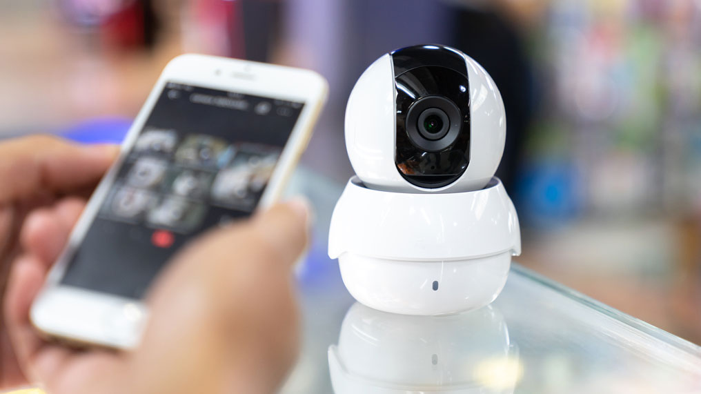 A smart security camera is controlled by a smartphone app.