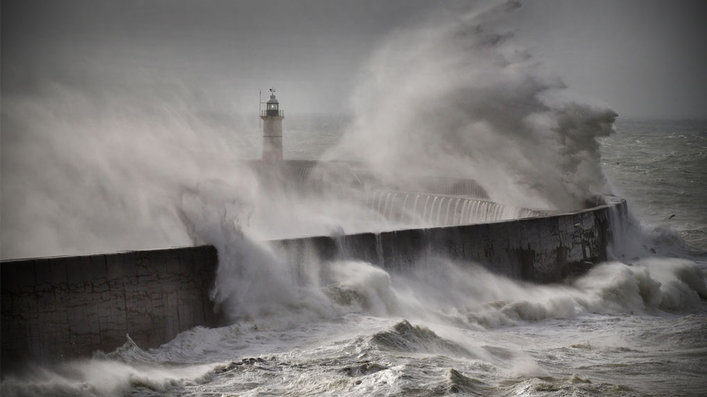 waves batter the sea wall