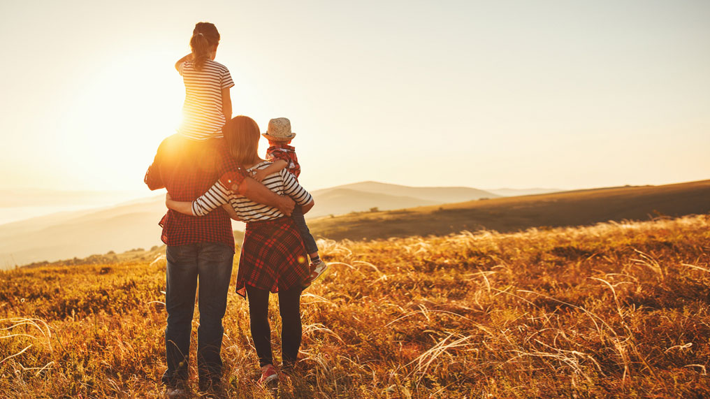 A family embrace in the sunset