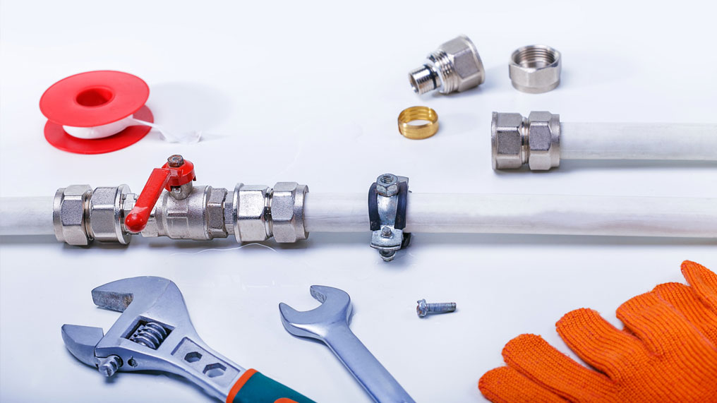 A plumber's tools and parts.