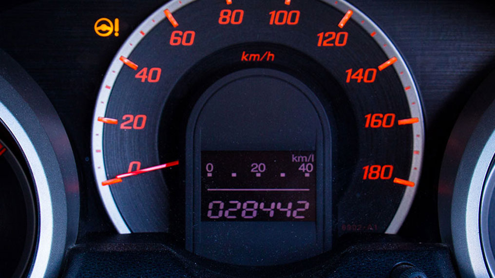 a car's dashboard shows it's current mileage