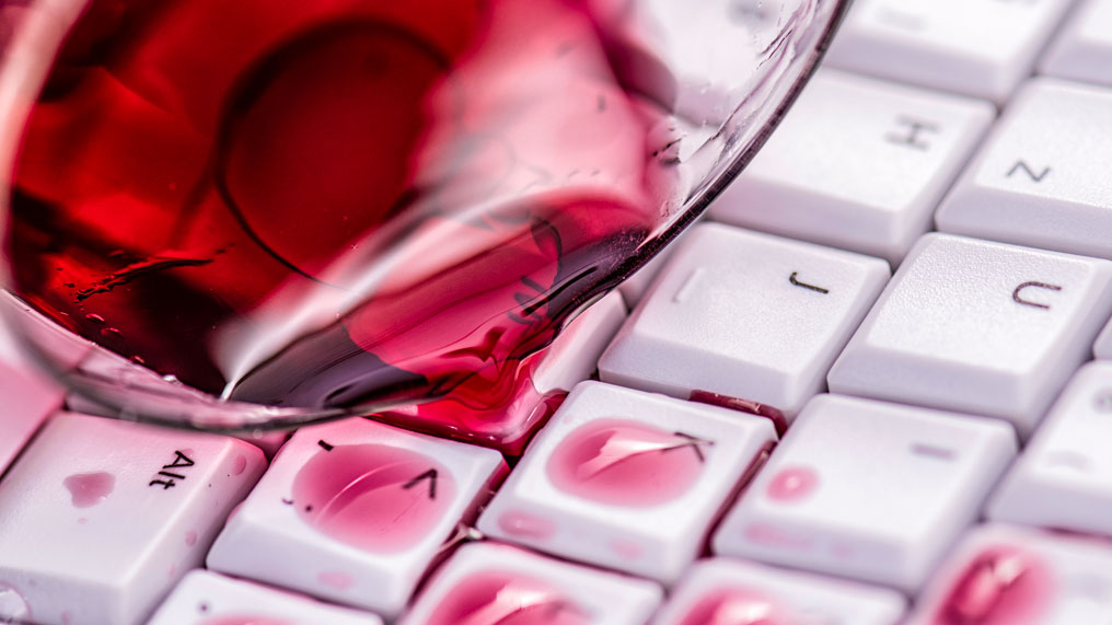 Red wine has spilled over a keyboard
