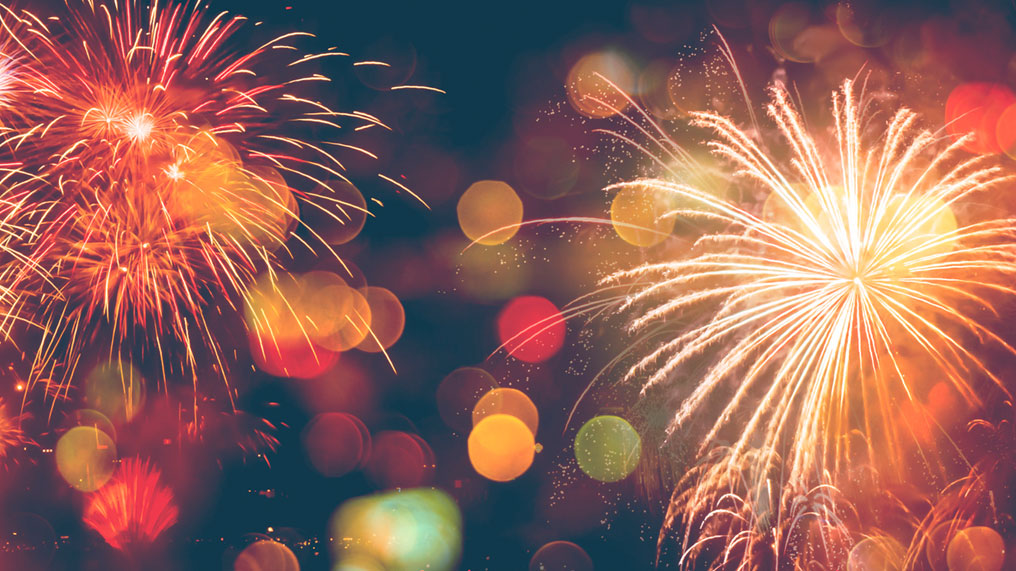 Fireworks fill the night sky.