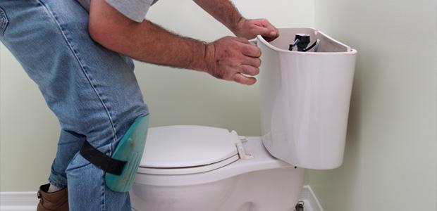 man unblocking a toilet
