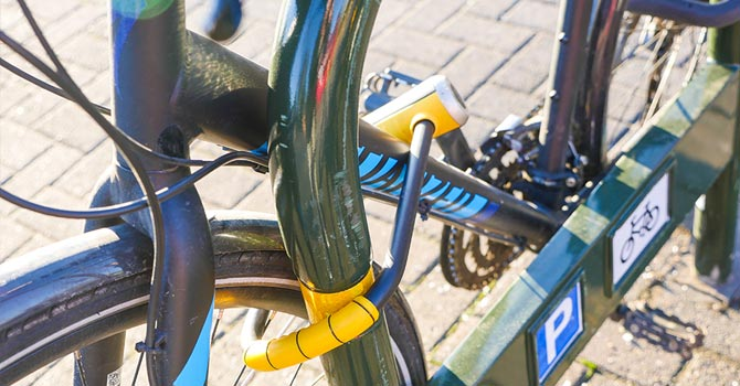 Bike locked with padlock on the pavement