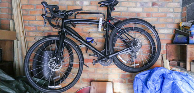 Black bikes on a wall-mounted rack